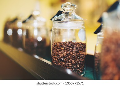 Glass jar with coffee beans in coffeshop