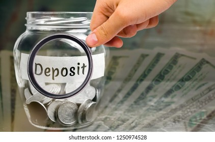 """Glass jar with coins and the inscription """" Deposit """". The amount of money transferred by a person to a credit institution in order to receive income in the form of interest. Investment in the bank"""
