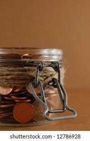 Glass Jar of coins. Savings Concept