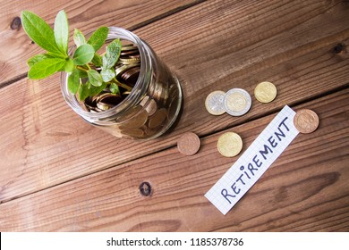 glass jar with coins and seedling. retirement and savings concept