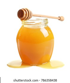 Glass jar with delicious honey and wooden dipper on white background