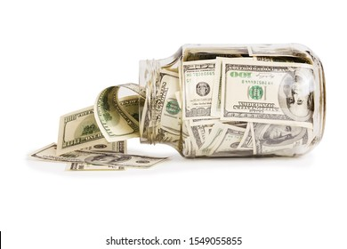 glass jar full of hundred us dollar banknotes laying on side - isolated on white