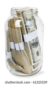 Glass jar full of hundreds of dollars isolated on white background