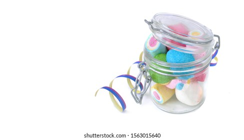 glass jar full of marshmallows on white background