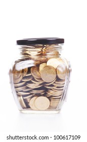 glass jar half full with  coins