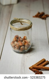 glass jar with hazelnuts