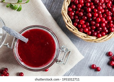 Glass jar with homemade lingonberry sauce. Canning lingonberry sauce, top view, flat lay