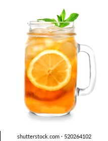 Glass jar of iced tea with lemon slices and mint on white background