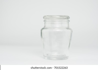Glass jar with lid closed from white background.