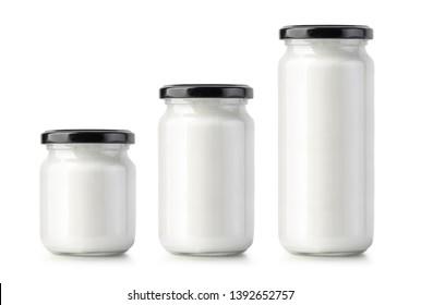 Glass jar of milk cream isolated on white