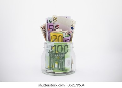 Glass Jar Overflowing With Euro Bills (has clipping path)