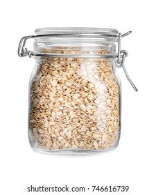 Glass jar with raw oatmeal on white background