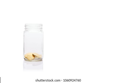 Glass jar with small amount of gold coins. Start of savings.  Savings and wealth management concept Horizontal
