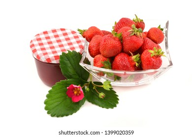 Glass jar of strawberry jam and fresh berries, isolated on white background. Preserved fruits.