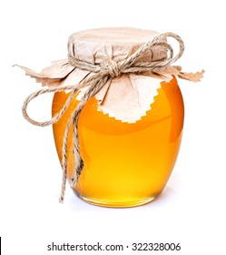 Glass jar with sweet honey isolated on white background