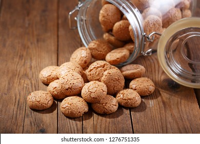 glass jar of traditional italian biscotti cookies on wooden table
