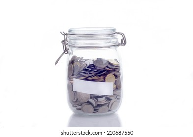 Glass jars with coins and empty space for text