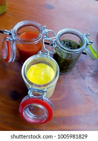 Glass jars filled with sauces.