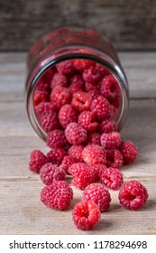 Glass jars with fresh ripe raspberries on table. Summer harvest. Healthy eating concept