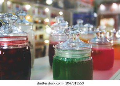 glass jars of jam and jelly for tasting on display.