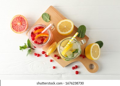 Glass jars with lemonade on wooden background. Fresh drink