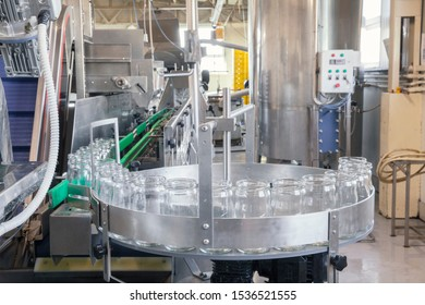 glass jars on the filling line in factory