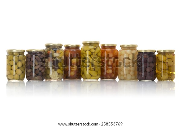 Glass Jars of Pickled Vegetables Isolated on White Background