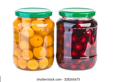 Glass jars with preserved cherries and apricots isolated on white background