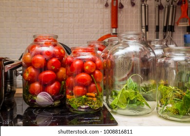 Glass jars with tomatoes; preserving tomatoes; wide-angle shot