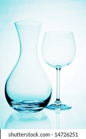 a glass and a jug in a blue background