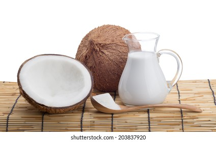 A glass jug with coconut milk