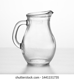 Glass jug isolated on white. Dishes.