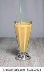 Glass of juice, smoothie, orange, lucuma