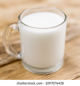 Glass kefir (milk) on a wooden background. The concept of diet, weight loss.