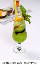 Glass of kiwi smoothie with lime apple