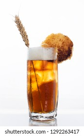 glass of kvass with bread and spike isolated on white background