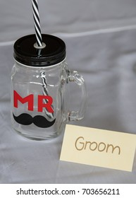 Glass and label for the Mr. or Groom at a wedding ceremony or reception