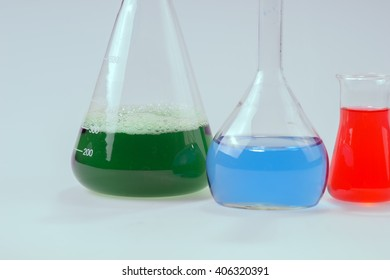 Glass laboratory apparatus with green and blue water