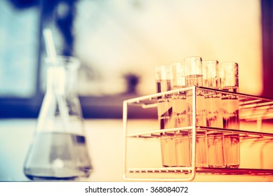 Glass laboratory chemical test tubes with liquid. Selective focus effect