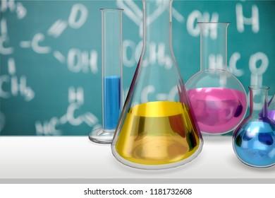 Glass laboratory flasks on background