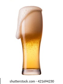 glass of lager beer with foam on white