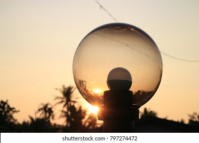 glass lamp with sunset