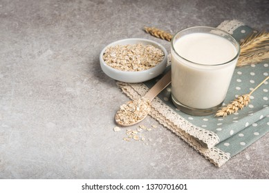 A glass of lean oatmeal milk on a stone background. vegetarian and organic drink food.