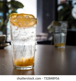 Glass of Lemon Tea with crushed ice cube.