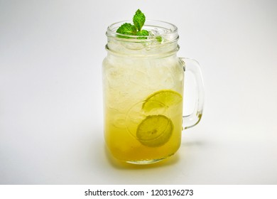 Glass of Lemonade Isolated Photography. Cold Fresh Drink Lime and Mint