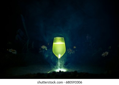 Glass with limoncello on a dark background