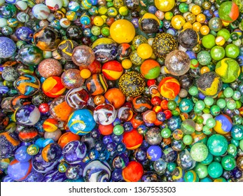 Glass marbles of different sizes in a color pattern as methaphor for multicultural community coexistence