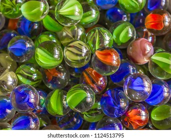 Glass Marbles on Textured Background