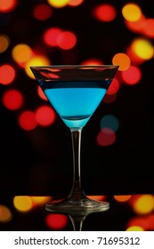 Glass of Martini in the colorful night light.
