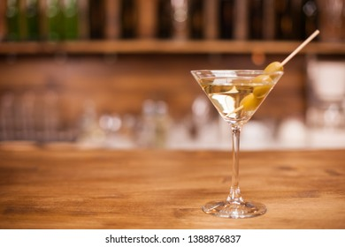 A glass of martini on the bar counter of a elegant restaurant. Cold drink. Tasty liqour.